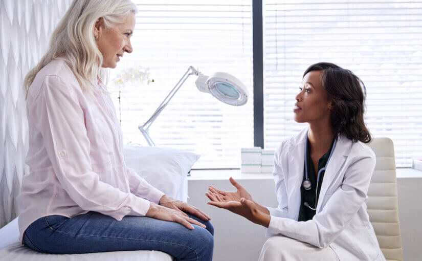 woman discussing vein health with her doctor
